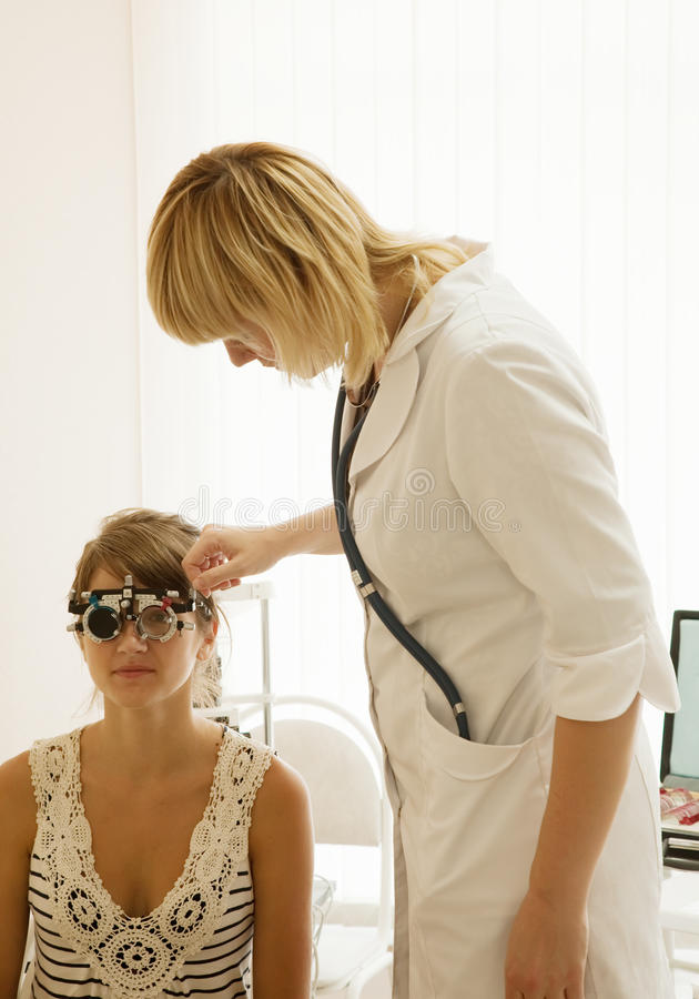 Oculist and patient. Testing eyesight in clinic royalty free stock photos