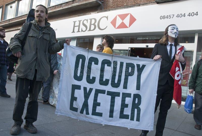 Ocupe activistas de Exeter fazem campanha fora de Exeter fotografia de stock