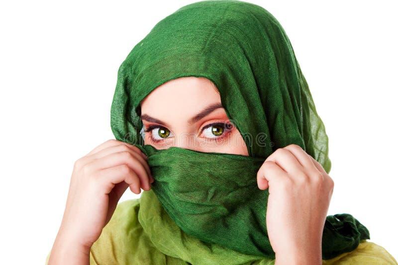 oczy stawiają czoło zielonego szalika fotografia stock