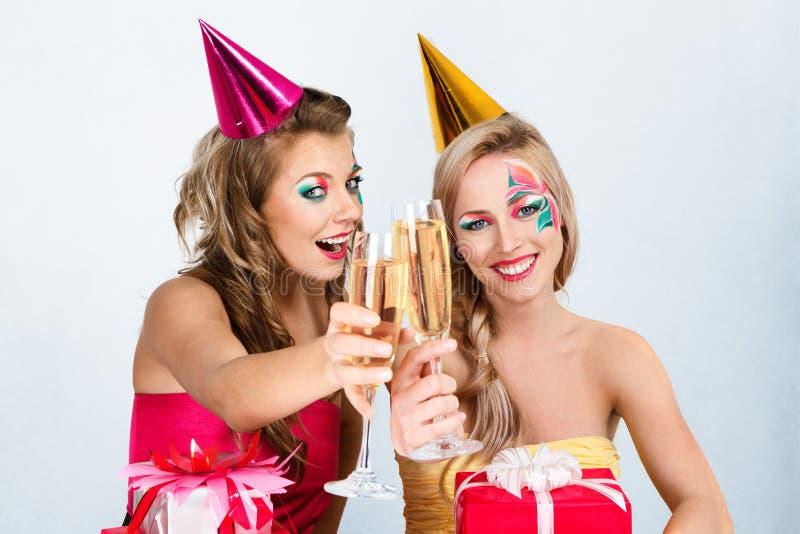 odświętność urodzinowe dziewczyny dwa obrazy stock