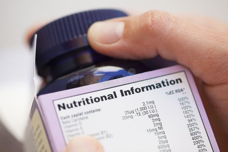 Odżywcza informacja o witamin pigułkach na pudełku obrazy stock