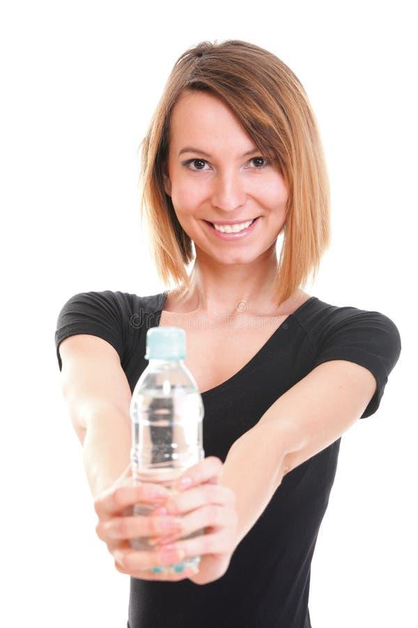 Od butelki odizolowywającej dziewczyny woda pitna fotografia royalty free