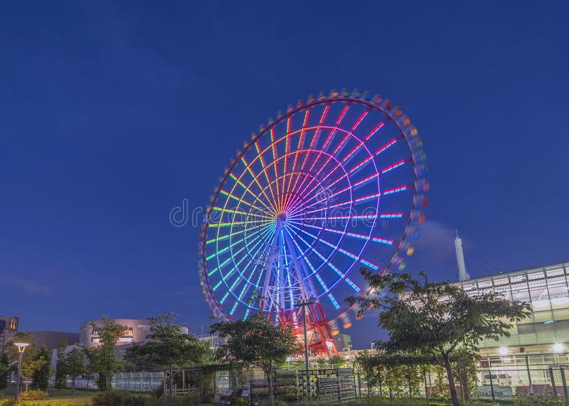 Odaiba illuminated Palette Town Ferris wheel named Daikanransha visible from the central urban area of Tokyo in the summer night stock photography