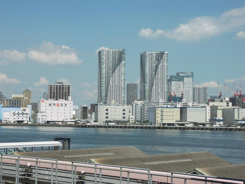 Odaiba skyscrapers bay area. Travel view of Odaiba featuring skyscrapers bay area. The image location is Tokyo in Japan, Asia royalty free stock photo