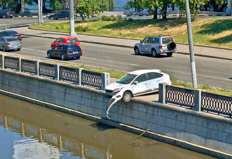 Odd accident 2. Car rammed the embankment fence stock photography