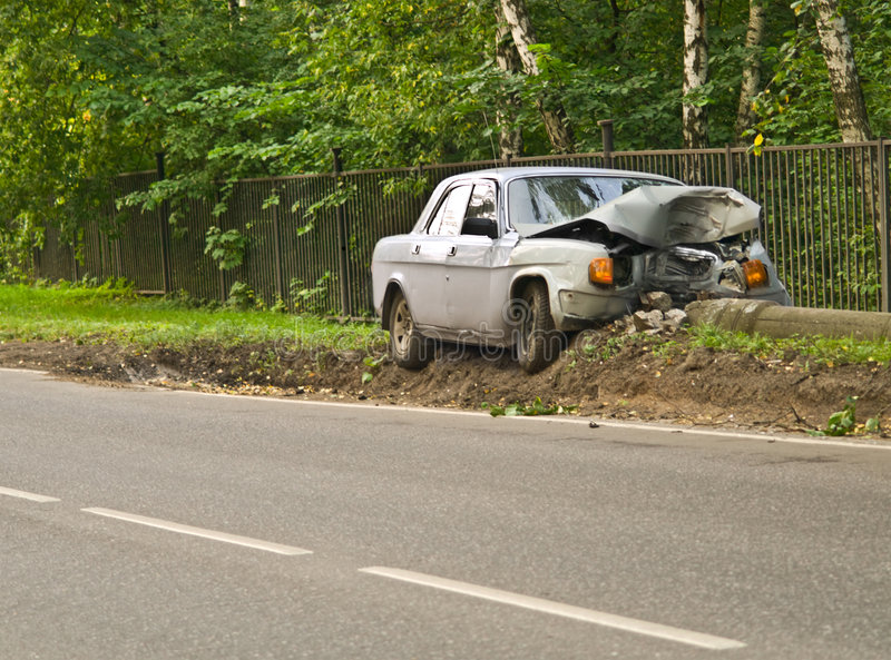 Odd accident. Big sedan tumbled down a column royalty free stock photo