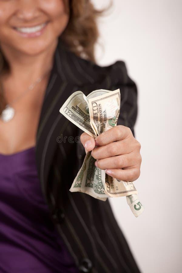 oddalony daje pieniądze zdjęcia stock