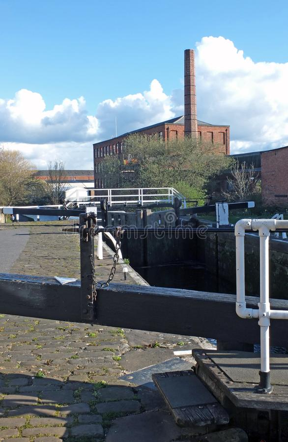 Oddy locks on the leeds to liverpool canal with the historic castleton mill in the background. Close up of oddy locks on the leeds to liverpool canal with the stock photo