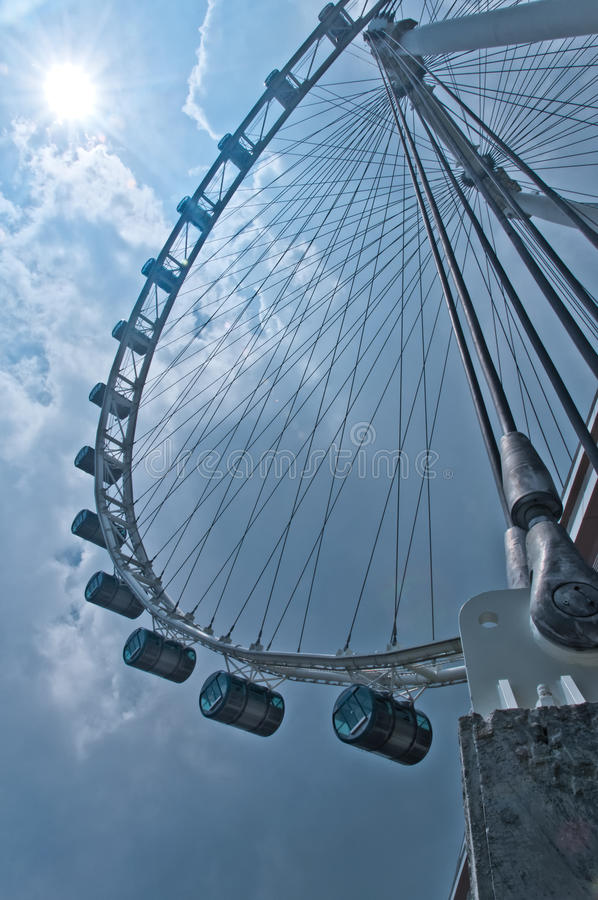 Ode to the Singapore Flyer. A dramatic rendition of the iconic Singapore Flyer, located in the Marina Bay waterfront of Singapore. The steel pylons of the royalty free stock images