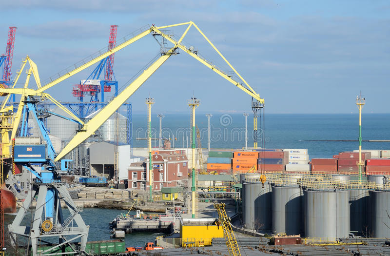 Odessa cargo port with grain dryers,transport containers and colourful cranes,Ukraine. ODESSA,UKRAINE - FEBRUARY 7:Odessa cargo port with grain dryers,transport royalty free stock photos