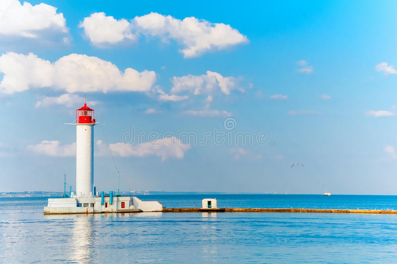 Odessa red and white lighthouse in bright sunny summer day. In the middle of the Black Sea. Blue sky and calm water stock image