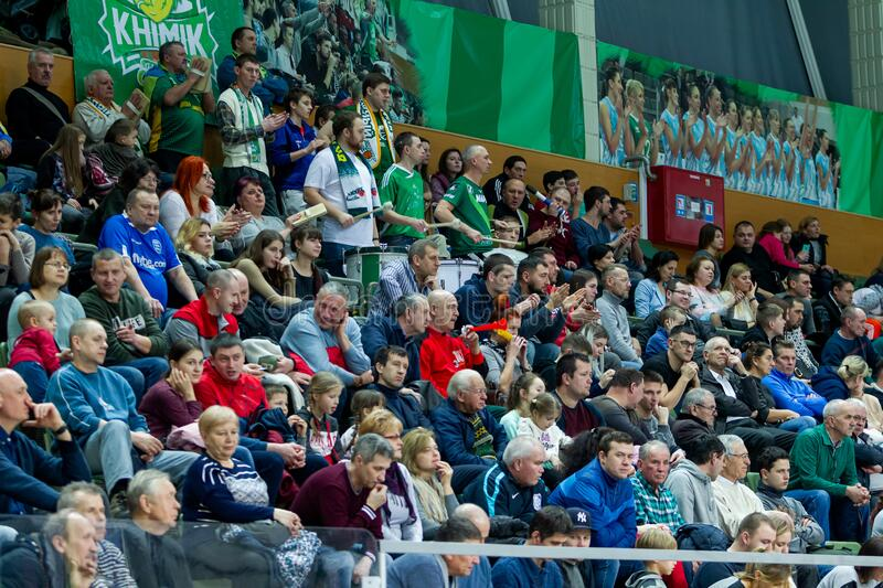 ODESSA, UKRAINA - CIRKA, 2020: Spectators in stands of gym during game of their favorite teams. Sports fans and spectators in royalty free stock photo