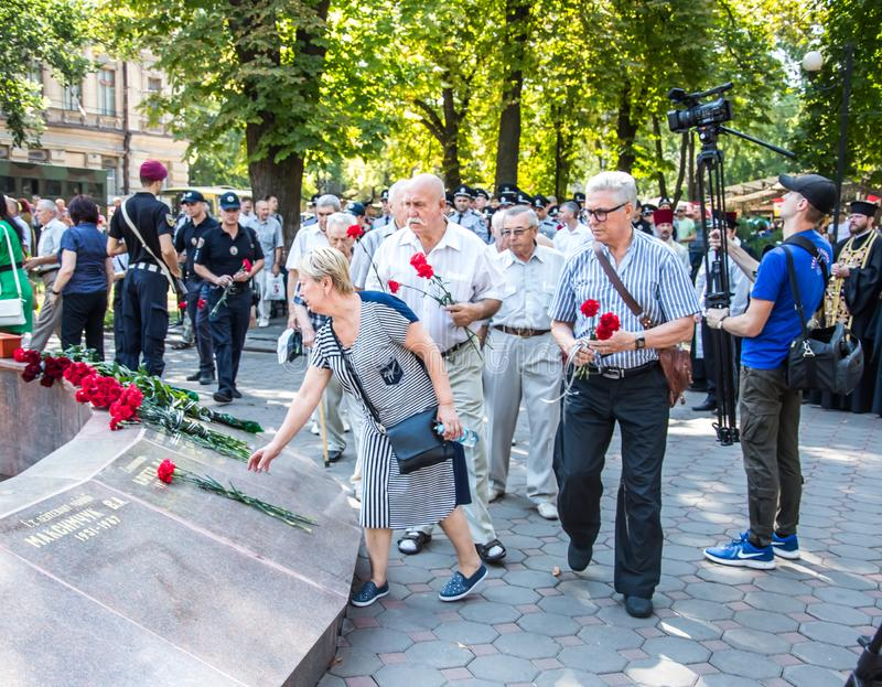 People gathering near  monument of reverence for police who become victims of criminals. Odessa, UKRAINE – AUGUST 22, 2019: People gathering royalty free stock photography