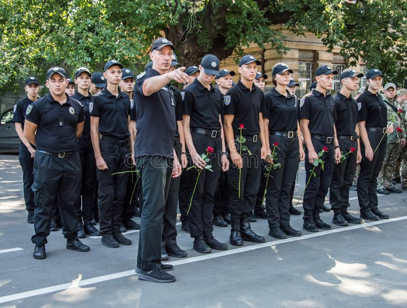 People gathering near  monument of reverence for police who become victims of criminals. Odessa, UKRAINE – AUGUST 22, 2019: People gathering royalty free stock photos