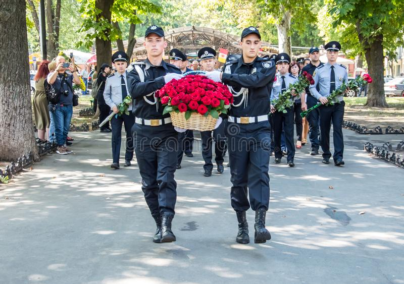 People gathering near  monument of reverence for police who become victims of criminals. Odessa, UKRAINE – AUGUST 22, 2019: People gathering stock image