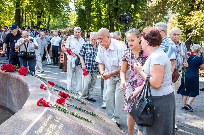 People gathering near  monument of reverence for police who become victims of criminals. Odessa, UKRAINE – AUGUST 22, 2019: People gathering royalty free stock photo