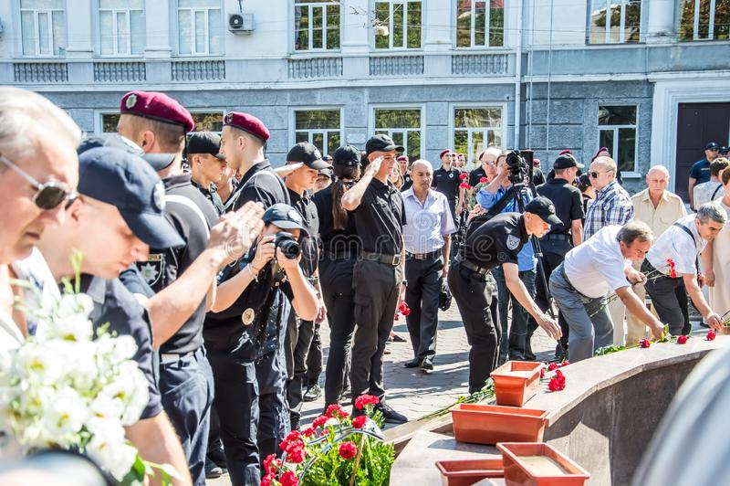People gathering near  monument of reverence for police who become victims of criminals. Odessa, UKRAINE – AUGUST 22, 2019: People gathering stock images