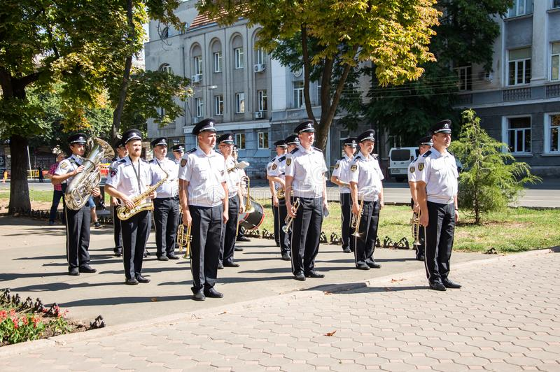 People gathering near  monument of reverence for police who become victims of criminals. Odessa, UKRAINE – AUGUST 22, 2019: People gathering stock photo