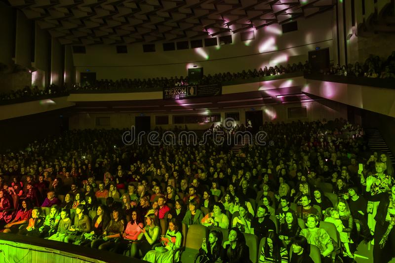 Odessa, Ukraine - April 12, 2019: Crowd of spectators at rock concert ALEKSEEV during music show. Crowds of happy people enjoy. Rock concert, raise their hands royalty free stock images