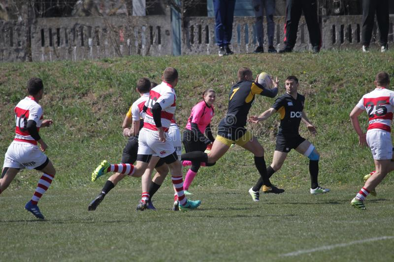 ODESSA, UKRAINE - April 6, 2019: National team of CREDO Odessa- OLYMPIC Kharkov Rugby Championship. Tense struggle of players. During rugby test for ball royalty free stock photos