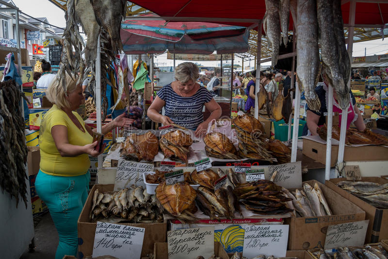 ODESSA, UKRAINE - AUGUST 13, 2015: Fish sellers in Privoz Market, Odessa, Ukraine stock image