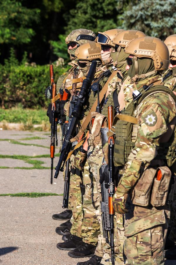 ODESSA, UKRAINE - August 1, 2018: Special forces of the Ukrainian police in the ranks in full combat form with special weapons. Ur. Kaain special forces of the stock photos