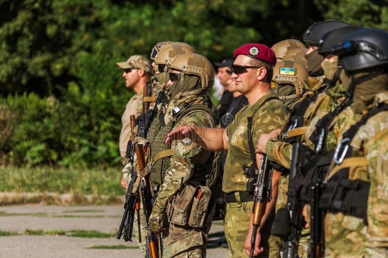 ODESSA, UKRAINE - August 1, 2018: Special forces of the Ukrainian police in the ranks in full combat form with special weapons. Ur. Kaain special forces of the stock image