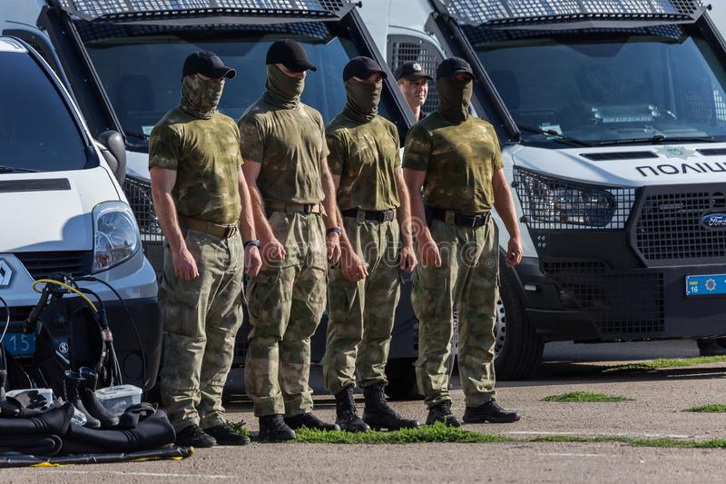 ODESSA, UKRAINE - August 1, 2018: Special forces of the Ukrainian police in the ranks in full combat form with special weapons. Ur. Kaain special forces of the royalty free stock photos