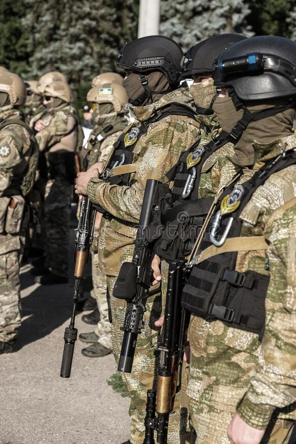 ODESSA, UKRAINE - August 1, 2018: Special forces of the Ukrainian police in the ranks in full combat form with special weapons. Ur. Kaain special forces of the stock photography