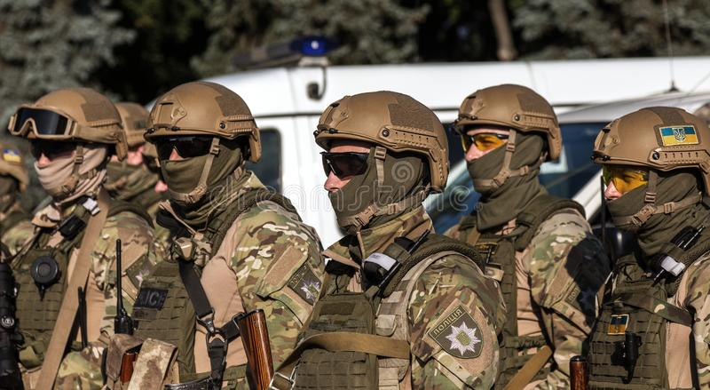 ODESSA, UKRAINE - August 1, 2018: Special forces of the Ukrainian police in the ranks in full combat form with special weapons. Ur. Kaain special forces of the royalty free stock images
