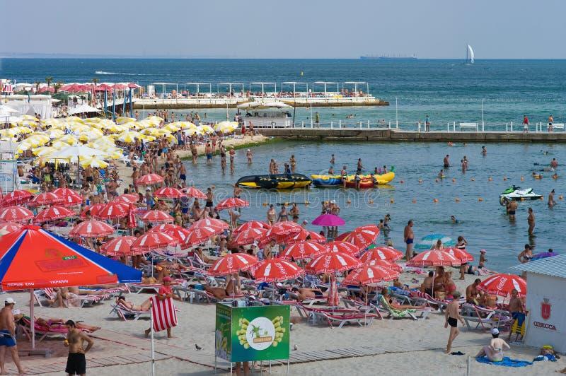 ODESSA, UKRAINE - August 15, 2015: Tourists sunbathe, swim and r stock image