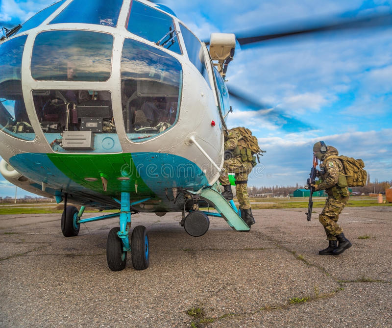Odessa, Ukraine - December 02, 2015: Soldiers loaded into the helicopter stock image