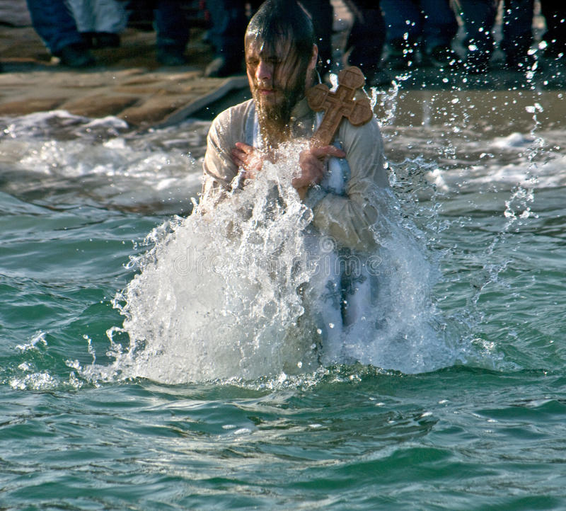 Odessa, Ukraine JANUARY 19, 2012: --:Peopls swimming in ice cold water Black Sea during Epiphany (Holy Baptism) royalty free stock image
