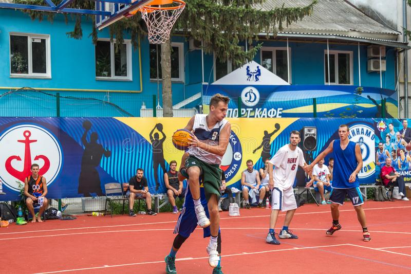 ODESSA, UKRAINE - JULY 28, 2018: Adolescents play basketball during 3x3 streetball championship. Young people play street basketba. Ll on an open city sports royalty free stock image