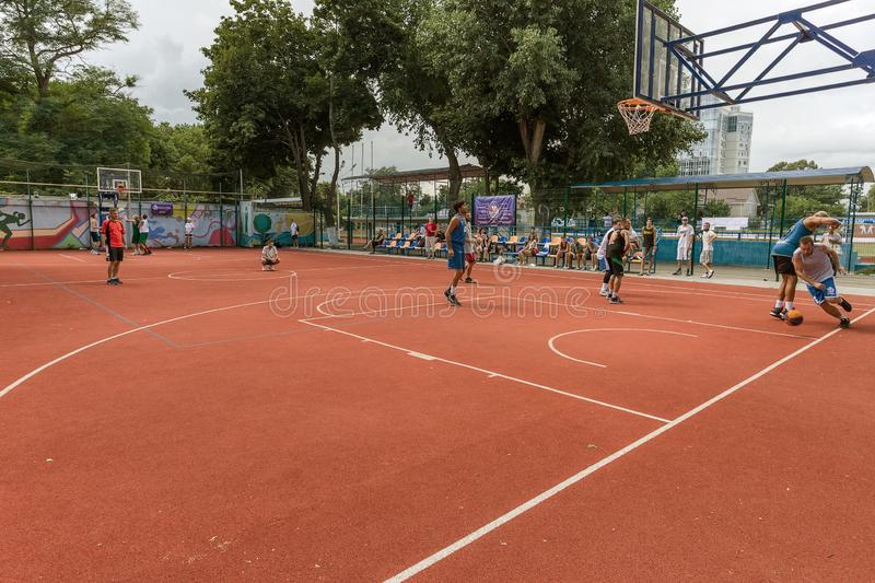 ODESSA, UKRAINE - JULY 28, 2018: Adolescents play basketball during 3x3 streetball championship. Young people play street basketba. Ll on an open city sports stock photography