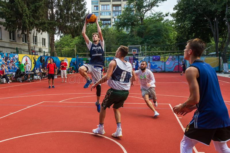 ODESSA, UKRAINE - JULY 28, 2018: Adolescents play basketball during 3x3 streetball championship. Young people play street basketba. Ll on an open city sports stock image