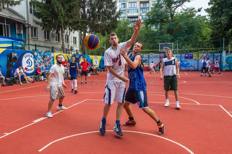 ODESSA, UKRAINE - JULY 28, 2018: Adolescents play basketball during 3x3 streetball championship. Young people play street basketba. Ll on an open city sports stock images