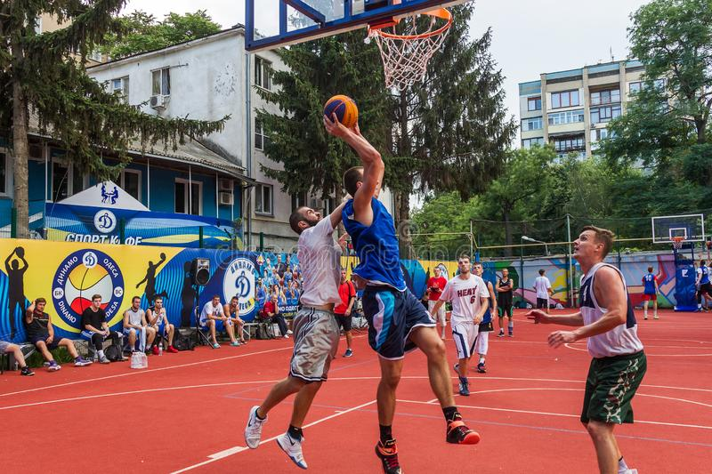 ODESSA, UKRAINE - JULY 28, 2018: Adolescents play basketball during 3x3 streetball championship. Young people play street basketba. Ll on an open city sports royalty free stock photos