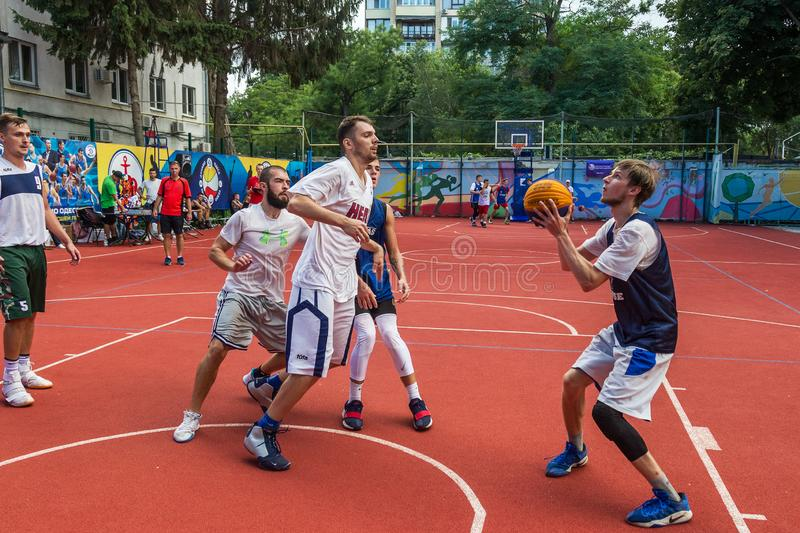 ODESSA, UKRAINE - JULY 28, 2018: Adolescents play basketball during 3x3 streetball championship. Young people play street basketba. Ll on an open city sports royalty free stock images