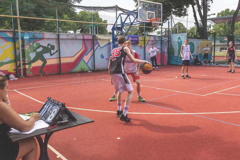 ODESSA, UKRAINE - JULY 28, 2018: Adolescents play basketball during 3x3 streetball championship. Young people play street basketba. Ll on an open city sports stock photos