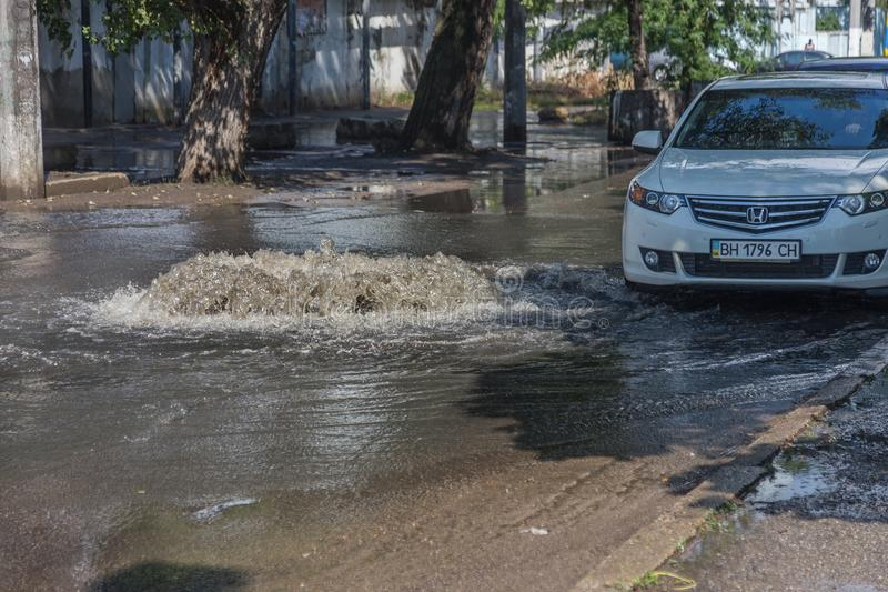 Odessa, Ukraine -3 July 2018: Driving cars on a flooded road during floods caused by rain storms. Cars float on water, flooding st. Reets. Splash on the machine stock photos