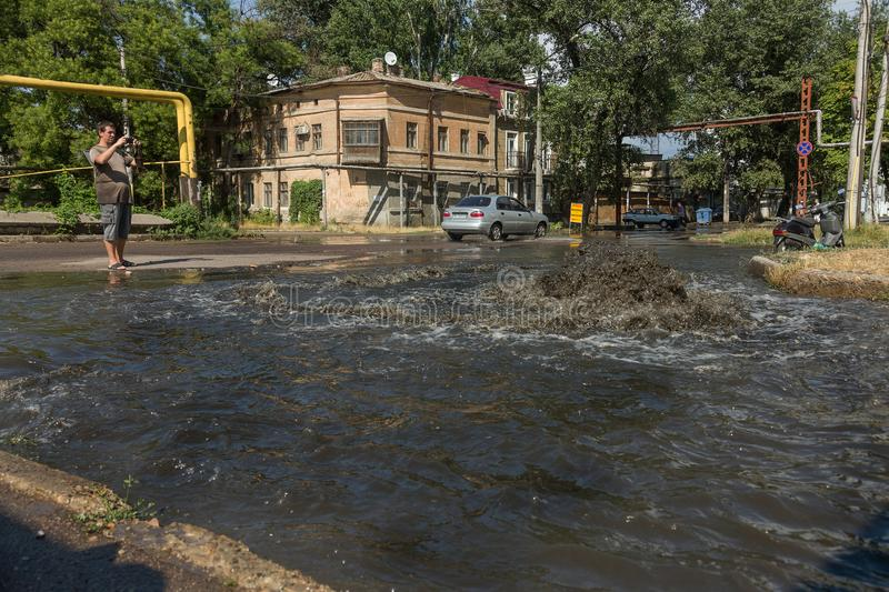 Odessa, Ukraine -3 July 2018: Driving cars on a flooded road during floods caused by rain storms. Cars float on water, flooding st. Reets. Splash on the machine stock photo