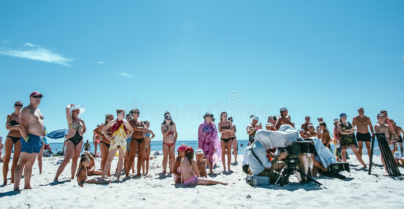 Group of people are watching something on the beach ,day royalty free stock photography