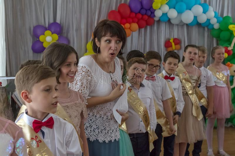 Odessa, Ukraine - May 31,2018: Children`s musical group sing and. Dance on stage during graduation concert of elementary school. Children play. Emotional royalty free stock images