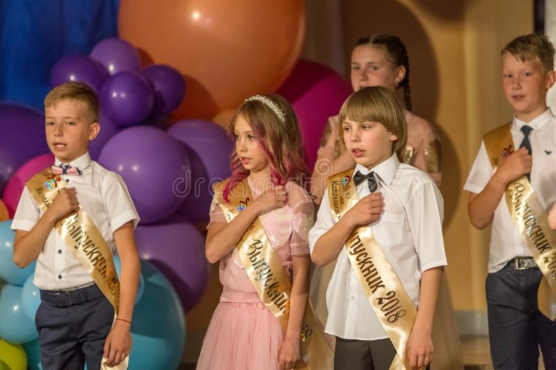 Odessa, Ukraine - May 31,2018: Children`s musical group sing and. Dance on stage during graduation concert of elementary school. Children play. Emotional royalty free stock photos