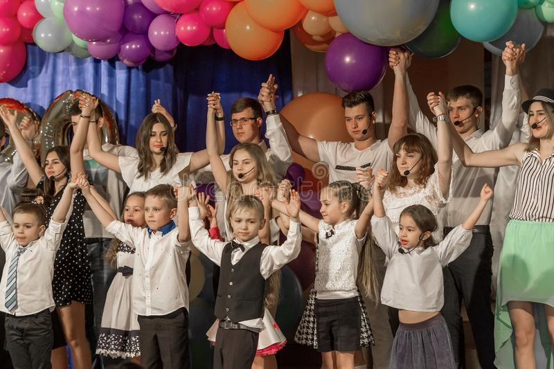 Odessa, Ukraine - May 31,2018: Children`s musical group sing and. Dance on stage during graduation concert of elementary school. Children play. Emotional royalty free stock photo