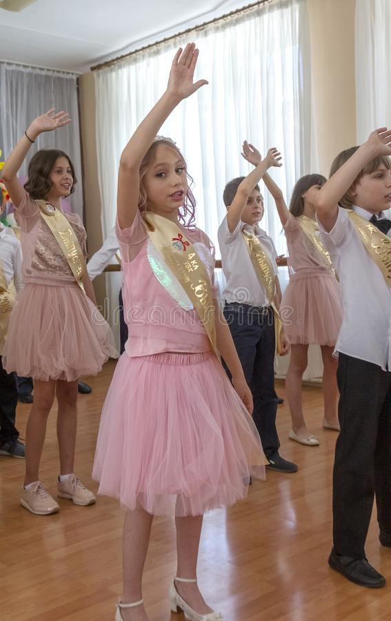 Odessa, Ukraine - May 31,2018: Children`s musical group sing and. Dance on stage during graduation concert of elementary school. Children play. Emotional royalty free stock image
