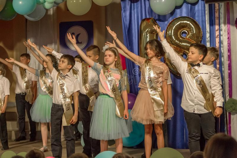 Odessa, Ukraine - May 31,2018: Children`s musical group sing and. Dance on stage during graduation concert of elementary school. Children play. Emotional stock photos
