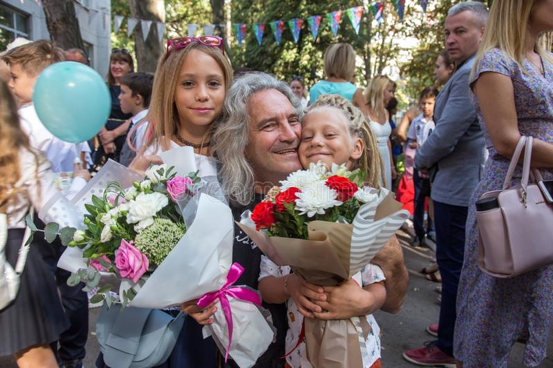 Odessa, Ukraine - May 31,2018: Children`s musical group sing and. Dance on stage during graduation concert of elementary school. Children play. Emotional stock images