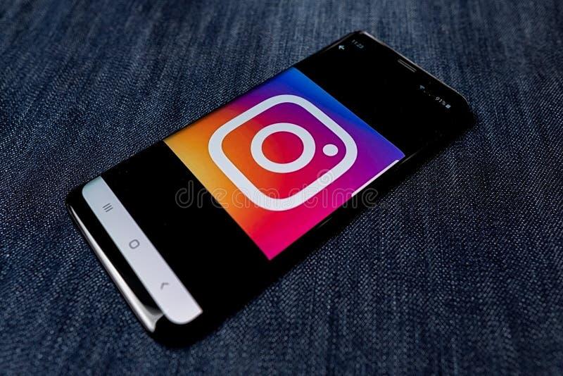 Odessa, Ukraine - October 26, 2019: Instagram app. Instagram logo visible on smartphone screen. Denim background. Soft. Focus stock photography